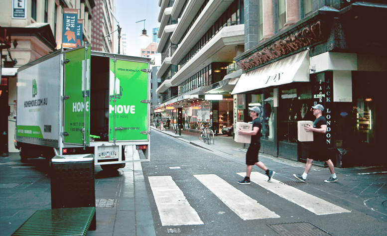 Apartment move experst, at zebra crossing in Melbourne laneway.